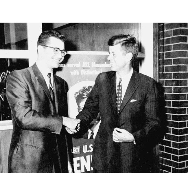 In 1960, presidential candidate Senator John F. Kennedy met attorney George Chansky in front of his Cabot Street law office.