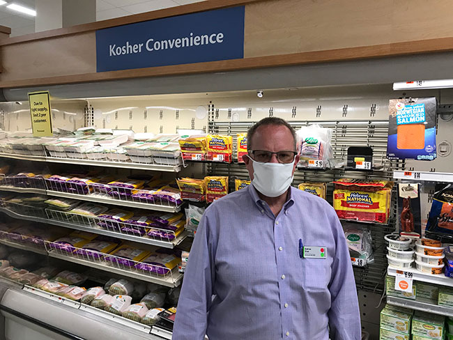 """I never thought I would have to run a store wearing a mask 10 to 12 hours a day,"" said Andrew Ziner, who manages the Stop & Shop in Swampscott. / Photo: Steven A. Rosenberg/Journal Staff"