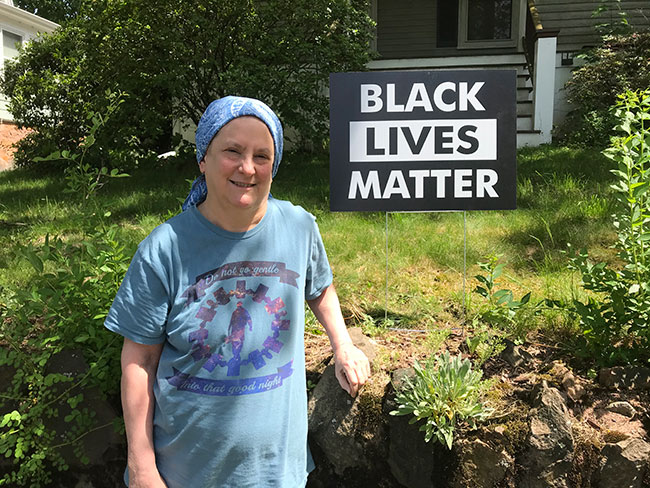 """I felt I had to do something,"" said Ellen Levine, who organized a drive to place 140 'Black Lives Matter' signs on lawns in Swampscott. / Photo: Steven A. Rosenberg/Journal Staff"