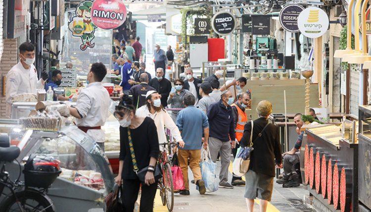 Israelis returned last week to shop at the Machane Yehuda market in Jerusalem. Photo: Marc Israel Sallem