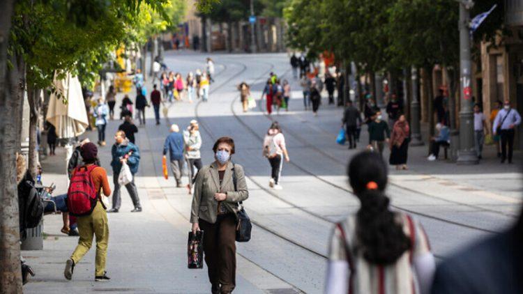 Israelis wear masks in downtown Jerusalem.