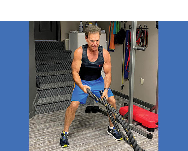 Although he is a member of a health club, Barry Comak of Peabody opts to work out in his home gym.