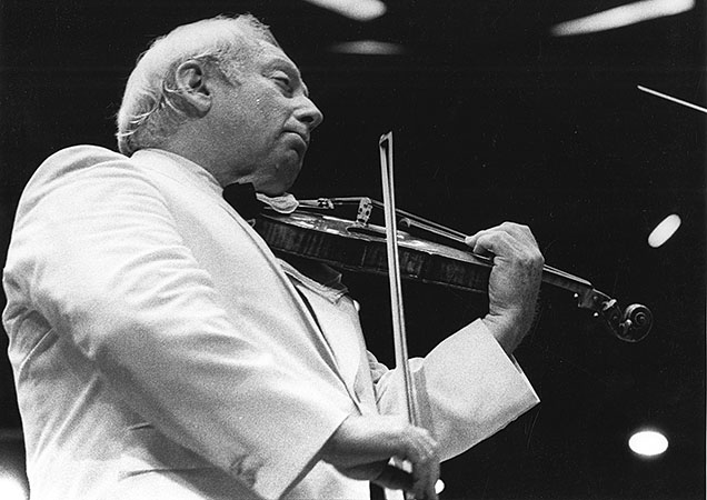 Isaac Stern, master violinist, performing with the Boston Symphony Orchestra at the Shed at Tangle­wood. The Boston Symphony Orchestra is celebrating the centennial of Stern's birth with a virtual gala on July 23. Courtesy BSO Archives