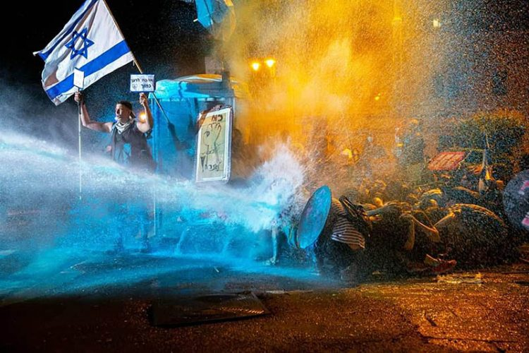 Police use a water cannon to disperse protesters in Jerusalem.