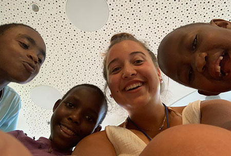 Lila Caplan, with children at the Save a Child's Heart organization in Israel.