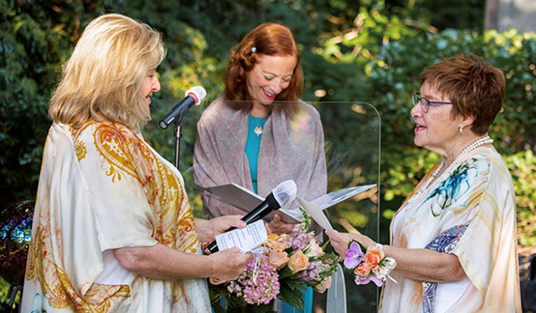 Helen Tieger and Barrie Atkin taking their wedding vows.