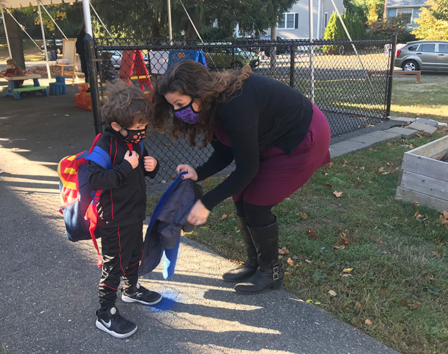 Jamie Greenstein and her son Aharon, 3, during drop-off at his preschool in Swampscott. / Photo: Ethan Forman/Journal Staff