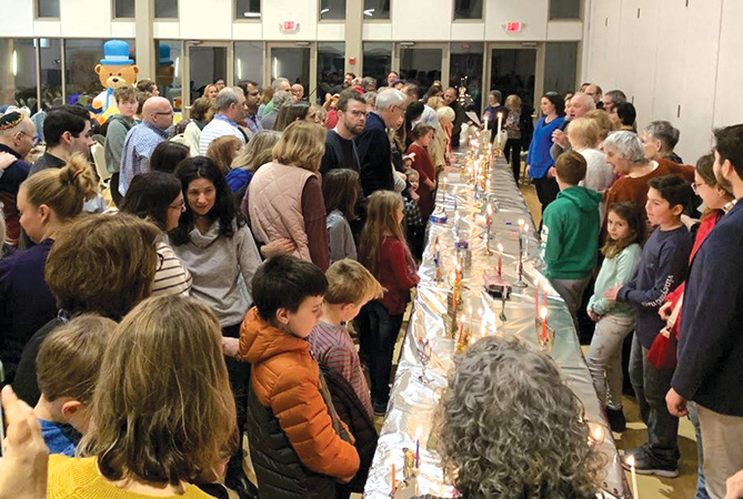 Last Hanukkah, members flocked to Temple Emanu-El's candle lighting. This year, many congregations have moved their holiday celebrations to Zoom due to the pandemic. Courtesy photo