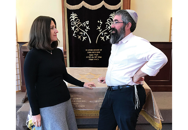 Raizel Schusterman and her husband Rabbi Nechemia Schusterman are marking Chabad of Peabody's 18th birthday year with a series of celebrations and initiatives, including the commissioning of a Torah of Unity and Healing. Photo: Ethan Forman/Journal Staff photo