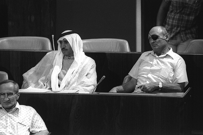 Photo: Moshe Milner, Israeli Government Press Office Knesset members Hamad Abu-Rabia and Moshe Dayan sit side by side during the Knesset debate over an interim disengagement agreement with Egypt in September 1975.