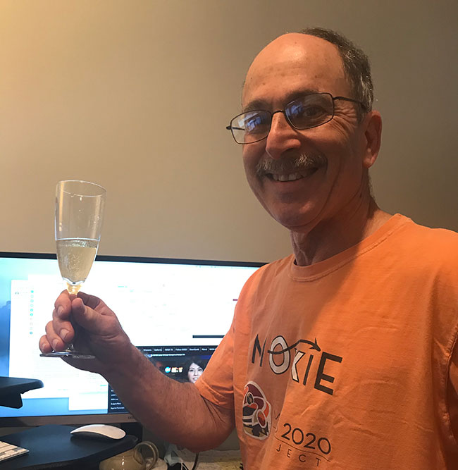 MIT researcher Michael Hecht celebrates after the NASA rover landed on Mars.