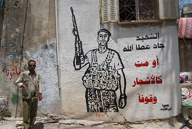 A mural of a suicide bomber in a Bethlehem UNRWA refugee camp. / Photo: Steven A. Rosenberg/Journal Staff