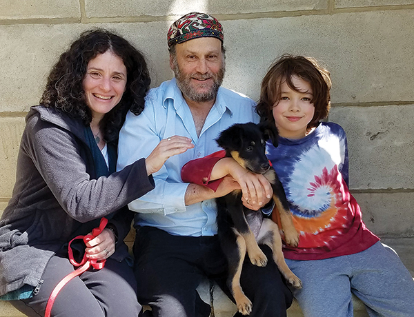 Rabbi Alison Adler, with her husband Chuck, son Leo and their dog, Cypress.