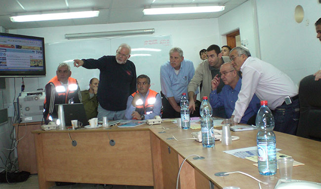 Alan Marcus, (standing, second from left), in Ashkelon's emergency command center.