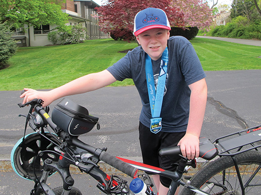 Ryan Freed, 13, of Swampscott, rode a virtual 750 miles and raised $4,500 for the Greater Boston Food Bank. Photo: Ethan M. Forman