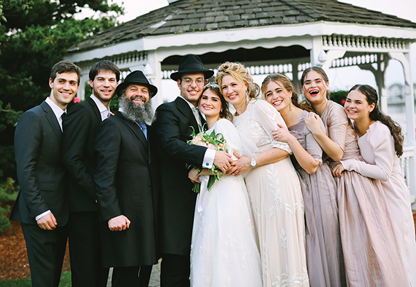 Rabbi Yossi Lipsker (third from left) with his family: Yaakov, Eliyahu, Moishe and Adina Wilhelm, Layah, Sheva, Batya and Michali.
