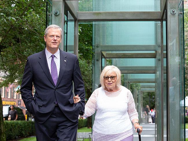 Massachusetts Governor Charlie Baker escorts Janet Applefield, a local Holocaust survivor, through the memorial. / Photo: CJP